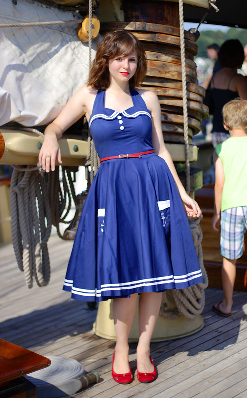 hell bunny sailor dress, hell bunny dress, hell bunny navy dress, sailor dress, full skirt, full skirt sailor dress, nautical dress, twirling, twirling in dress, girl twirling in a dress, on a boat, hell bunny, retro sailor dress, retro fashion, vintage fashion, halter sailor dress
