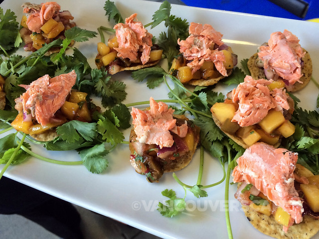 Summer mango salsa with flaked salmon in Tostitos Multigrain Rounds