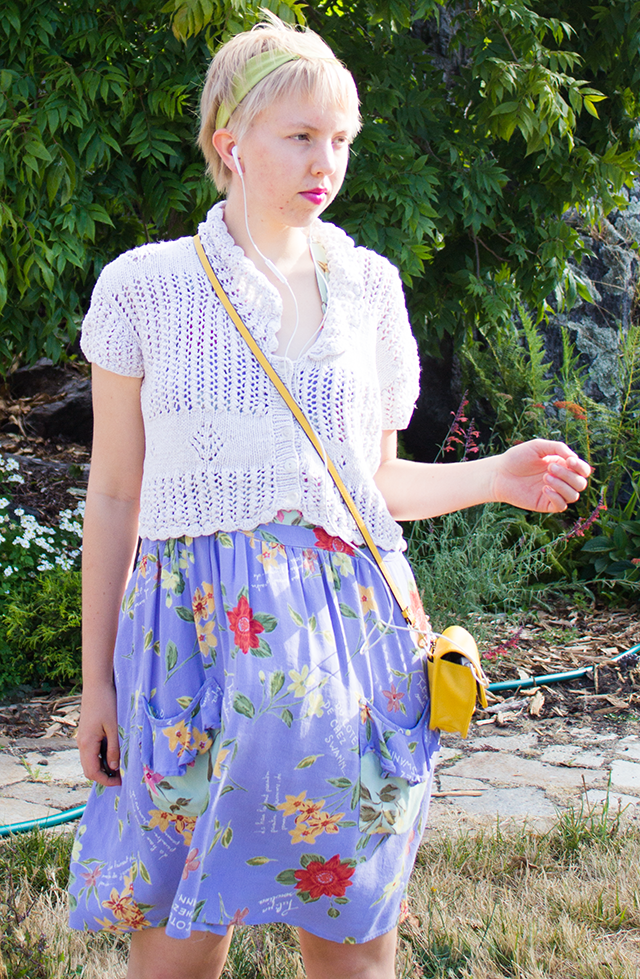 blonde pixie cut, crochet cropped cardigan, periwinkle floral dress, yellow crossbody purse