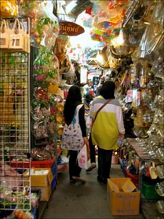 Image of Chatuchak Market near Charoen Pokphand Foods (CPF) Plc. Co. Ltd.. shopping thailand market bangkok creativecommons boxes bags clutter philscamera chatuchak indoormarket chatuchakweekendmarket