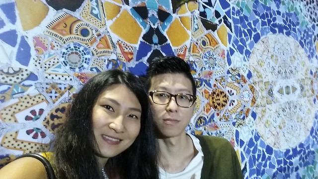 Us, against a wallpapered wall of mosaic that reminds us of Spain.