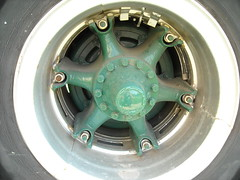 automotive exterior(0.0), steering wheel(0.0), tire(1.0), automotive tire(1.0), wheel(1.0), rim(1.0), alloy wheel(1.0), hubcap(1.0), spoke(1.0),