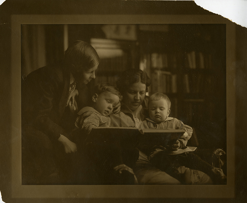 Grace Noll Crowell reading with her sons, Dean, Reid, and Norton, Sioux City, Iowa, 1914 or 1915