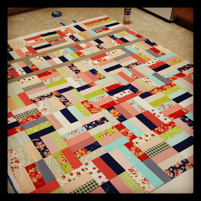 Getting in a quick work out with spary basting a #misskate  quilt from my @southernfabric winnings