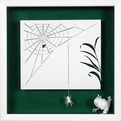 paper cut greeting card with frog and spider web with spider