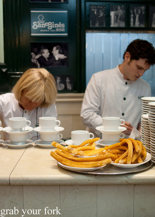 Churros at the counter at Chocolateria San Gines in Madrid, Spain