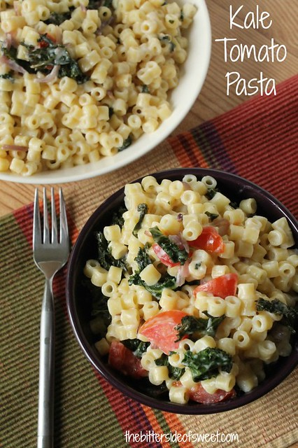 Kale Tomato Pasta in a bowl with a fork.