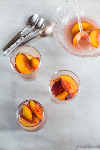Chilled peaches in wine