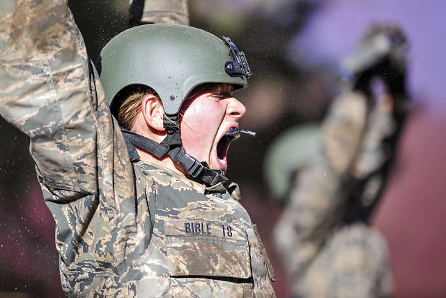Basic Cadet Ashlen Bible strains to hold her M16-A2 rifle above her head during a training drill in Jacks Valley, Colorado Springs, Colo. on July 22, 2014. (Air Force photo/Liz Copan)