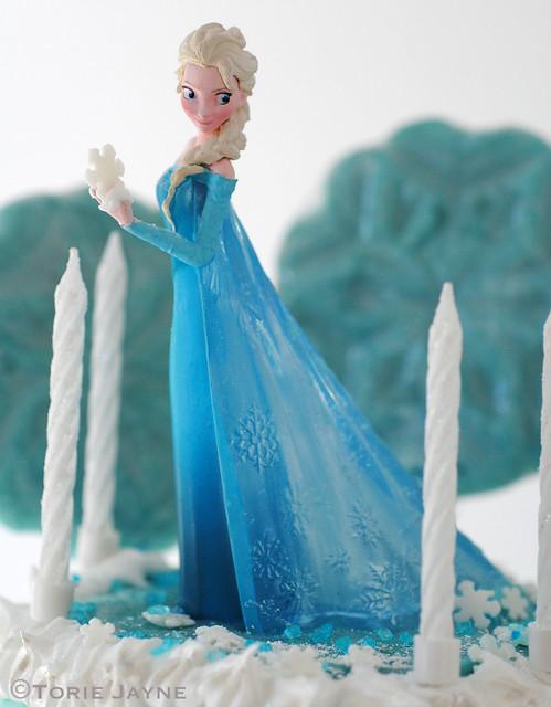 Princess Elsa holding a sugar snowflake