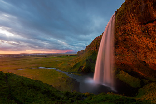 sunset waterfall iceland seljalandfoss