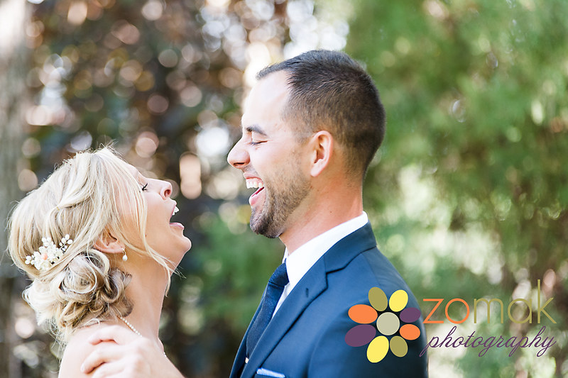 Bride and groom share a laugh during their first look on their wedding day.