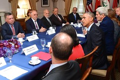 President Obama, flanked by National Security Adviser Susan Rice and U.S. Secretary of State John Kerry, addresses reporters at a meeting with members of the anti-ISIL coalition - including leaders from Iraq, Saudi Arabia, Qatar, the United Arab Emirates, Jordan, and Bahrain - on the sidelines of the United Nations General Assembly meeting in New York City on September 23, 2014. [State Department photo/ Public Domain]