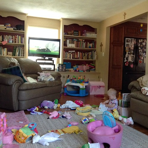 "The state of my living room after a day of momma being sick. The tv has been on all day....PBS so that counts as educational right? The baby has been ""reading"". I won't show you the kitchen."