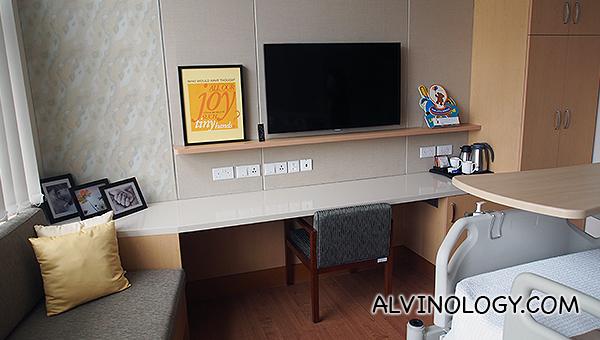Sofa, work desk and TV