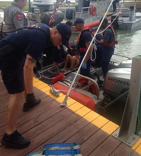 A Coast Guard Station Port O'Connor, Texas, boatcrew medevaced a 49-year-old woman and brought her back to the station after the boat she was on ran hard aground and ejected her near Pass Cavallo Tuesday, July 22, 2014. The boat had five people aboard, including a child who was also ejected, but suffered only minor injuries. U.S. Coast Guard photo by Petty Officer 1st Class Andrew Kendrick.