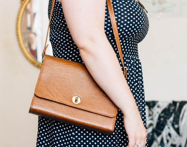 polka dot dress and vintage leather bag