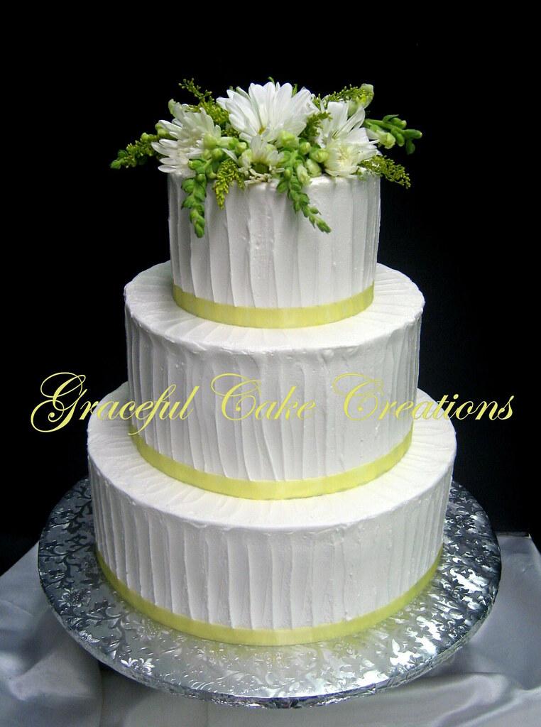 Yellow Wedding Cake With Daisies