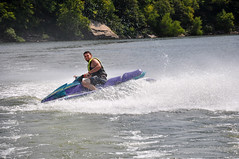 towed water sport(0.0), waterskiing(0.0), wakeboarding(0.0), rapid(0.0), powerboating(0.0), boat(0.0), vehicle(1.0), sports(1.0), recreation(1.0), outdoor recreation(1.0), motorsport(1.0), boating(1.0), extreme sport(1.0), water sport(1.0), jet ski(1.0), personal water craft(1.0), watercraft(1.0),