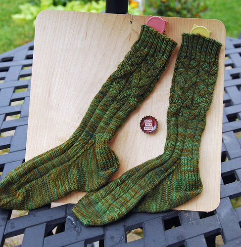 Finished handknit socks adapted from Cadence pattern in String Theory yarn