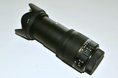 gun barrel(0.0), flashlight(0.0), camera lens(0.0), optical instrument(1.0),