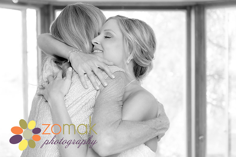 An emotional moment as the bride and her mother embrace on her wedding day.