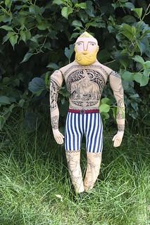 blond tattooed man in the garden