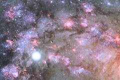 NASA Telescopes Uncover Early Construction of Giant Galaxy