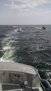 A 47-foot Motor Life Boat crew from Coast Guard Station Manasquan Inlet, N.J. tows a 25-foot pleasure craft Sunday, Aug. 31, 2014. The Coast Guard rescued six people from the pleasure craft after the boat started taking on water one mile off shore from Sea Grit, N.J. (U.S. Coast Guard photo)