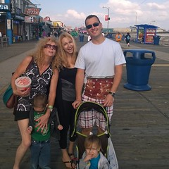 "Enjoying the boardwalk and trying to get two little munchkins to ""say cheese"""
