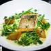 Sautéed Sea Bass, Sweet Garlic Sauce, Crunchy Potatoes.and Sweet Peas
