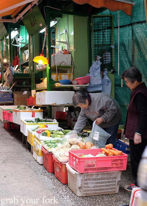 Morning shoppers at the Graham Street market, Central district, Hong Kong