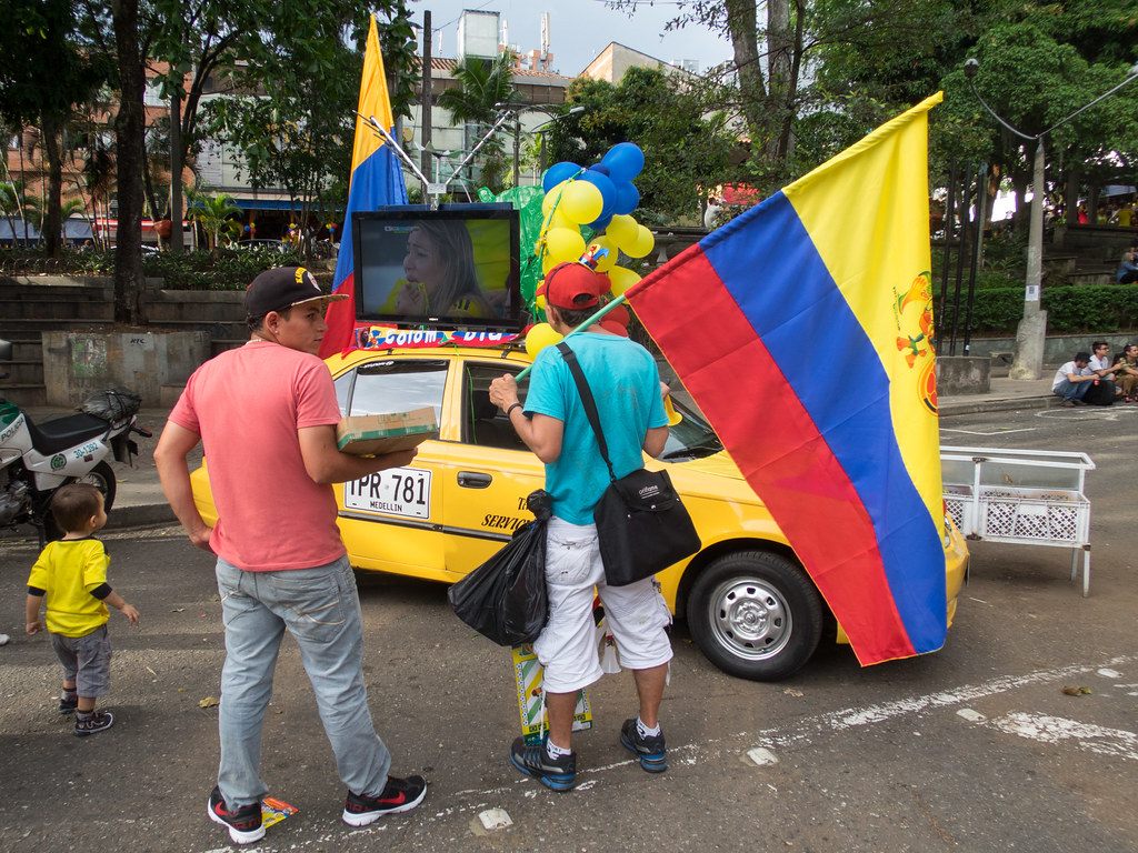 A taxi driver having some fun with the 2014 World Cup
