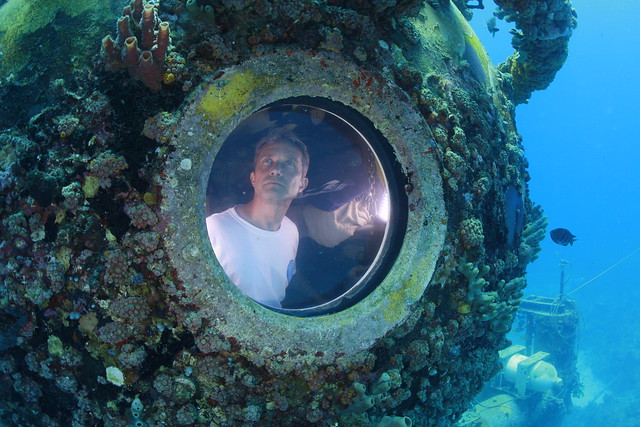 Fabien Cousteau looks out of a porthole