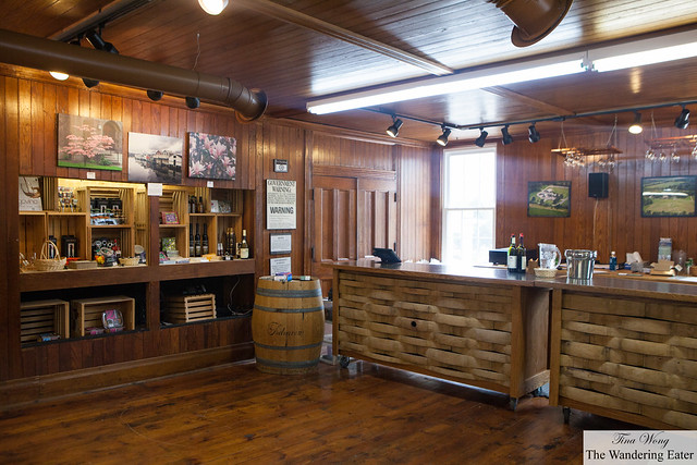 The wine tasting bar area and wine accessories sold on the left