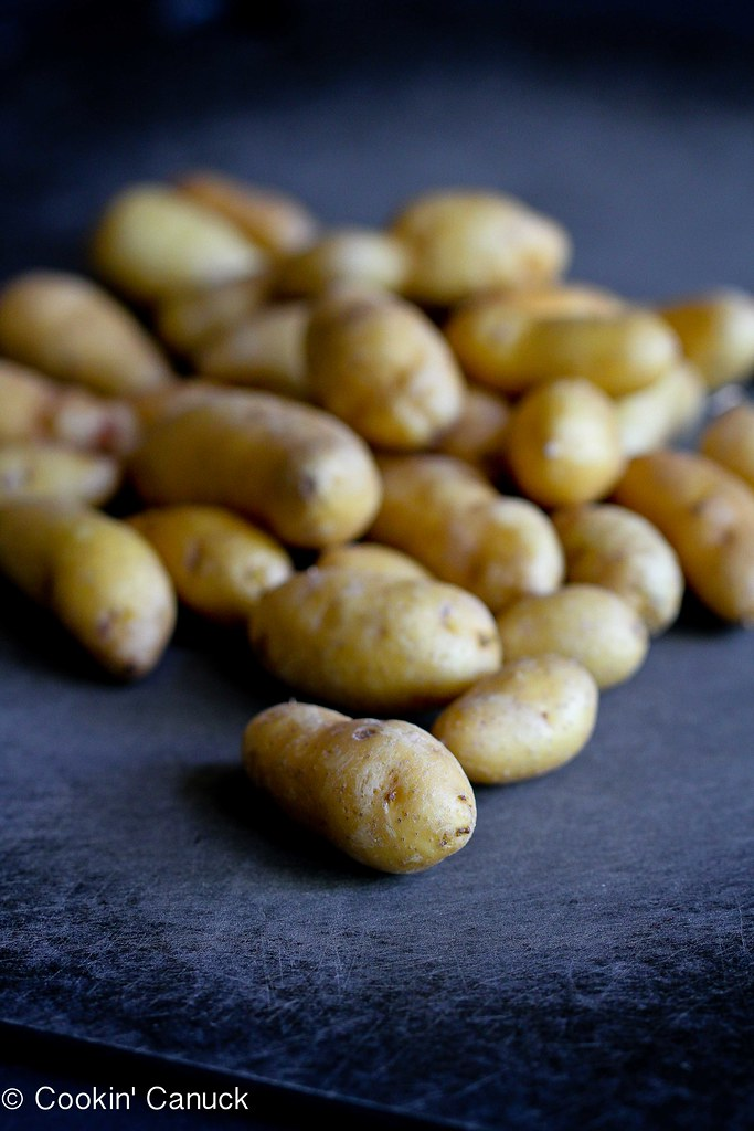 Fingerling potatoes on a cutting board.