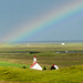 Rainbow Over Church In Iceland by baldheretic