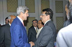 U.S. Secretary of State John Kerry Greets Vineet Nayar of the Sampark Foundation at a Brookings India Luncheon in New Delhi on July 31, 2014. [State Department photo/ Public Domain]