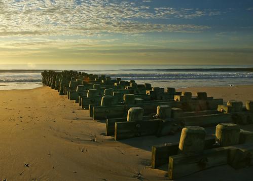 ocean travel sea usa beach sunrise dawn coast newjersey sand alone atlantic shore jersey pilings seashore midatlantic seagirt hhsc2000