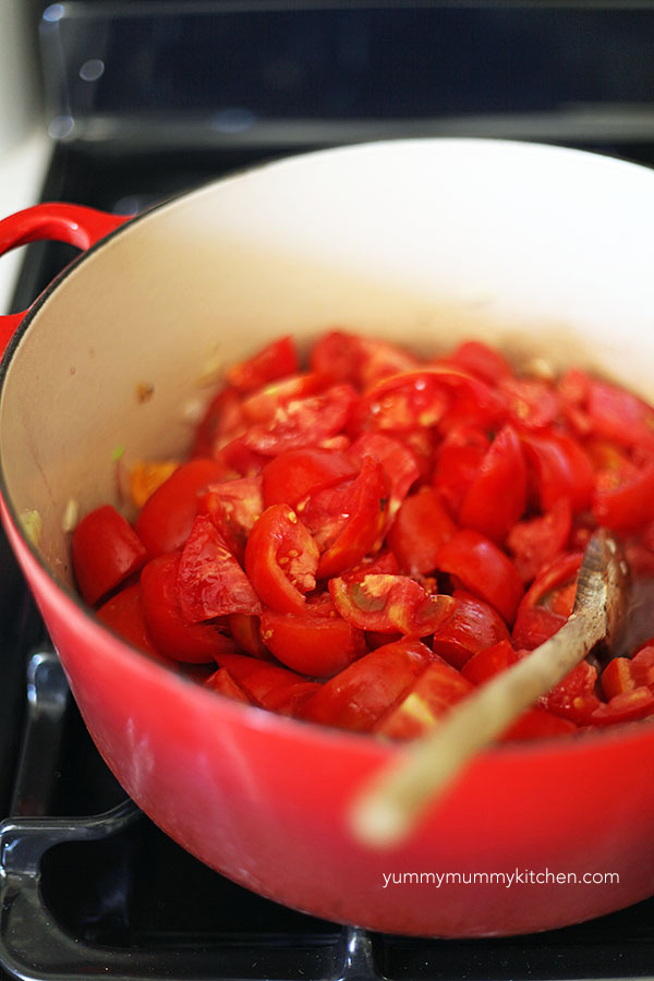 Fresh tomatoes in a red pot