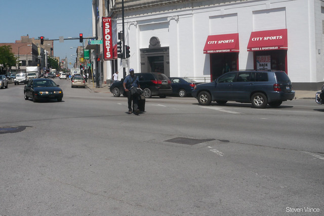 There's a very long crosswalk distance across Division Street at Milwaukee Avenue