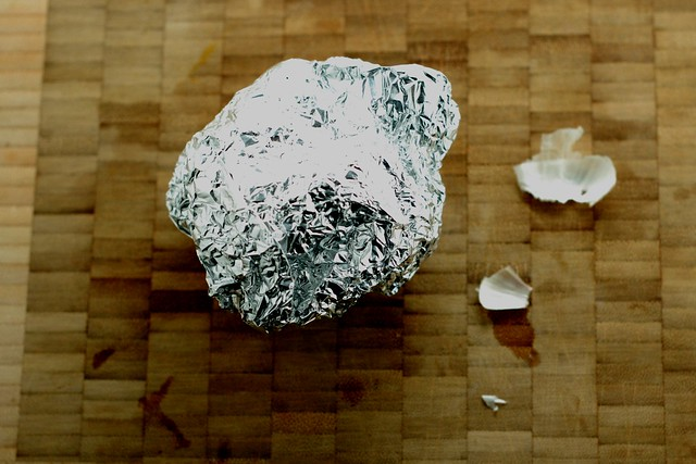 Head of garlic wrapped in tin foil by Eve Fox, the Garden of Eating, copyright 2014