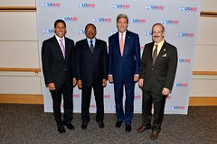 U.S. Secretary of State John Kerry poses for a photo with U.S. Agency for International Development Rajiv Shah, Tanzanian President Jakaya Kikwete, and Congressman Eliot Engel at the 2014 Frontiers in Development Forum at the Ronald Reagan Building in Washington, D.C., on September 19, 2014. [State Department photo/ Public Domain]