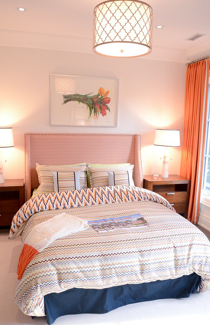 Orange eclectic bedroom.Princess Margaret Showhome in Oakville