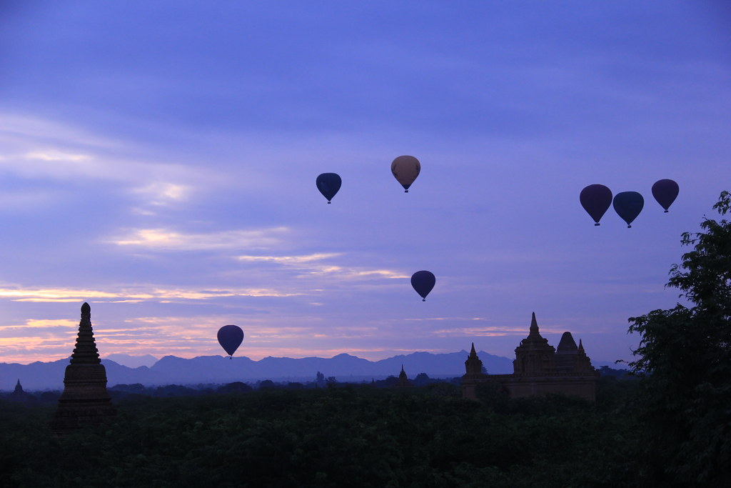 Hot air balloons floating over Bagan at sunrise