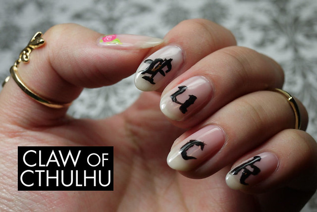 """Fuck"" Calligraphy and Thumb Roses Nail Art"