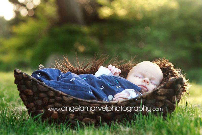 newborn baby boy outdoor basket
