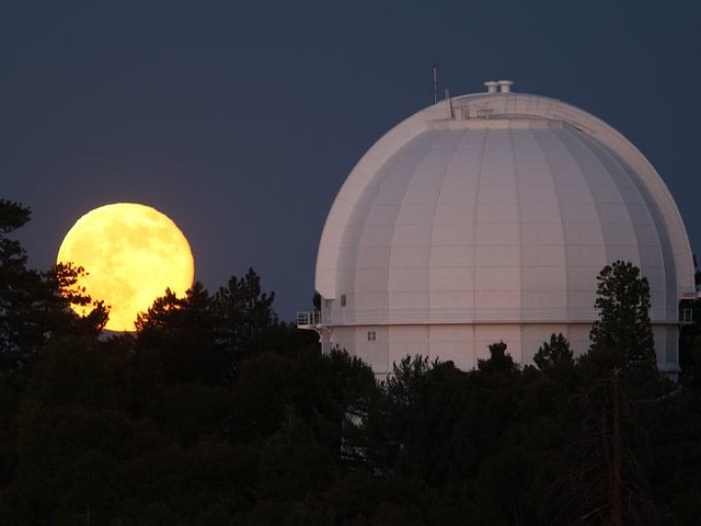 Super Moon Photos moon rises behind the historic Mount Wilson Observatory