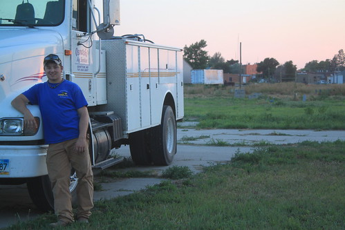 Posed by the service truck at our new temporary home.