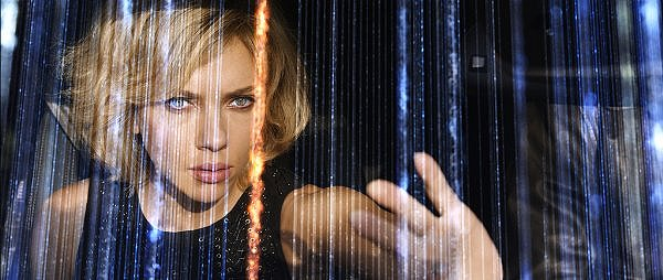 Scarlett Johansson barely earns a paycheck in LUCY.